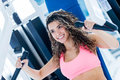 Woman exercising at the gym her chest on a machine Royalty Free Stock Images