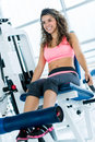 Woman exercising at the gym and looking very happy Stock Photos