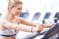 Woman exercising in a gym working out at health club Royalty Free Stock Photography
