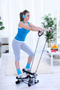 Woman exercising at home on stepper trainer Royalty Free Stock Photography