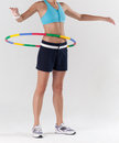 A woman exercising with hula hoop Stock Photo