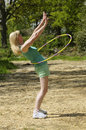Woman exercising with a hula hoop Royalty Free Stock Photo
