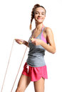 Woman exercising with a jump rope happy Stock Photos