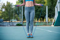 Woman exercising with jump rope Royalty Free Stock Photo