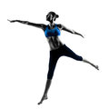 Woman exercising jumping stretching dancing one caucasian in silhouette studio isolated on white background Stock Images