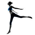 Woman exercising jumping stretching dancing one caucasian in silhouette studio isolated on white background Stock Image