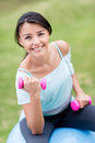Woman exercising outdoors with a pilates ball Royalty Free Stock Photos