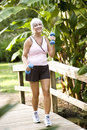 Woman exercising in park walking with hand weights Royalty Free Stock Photography