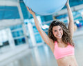 Woman exercising with a pilates ball at the gym Royalty Free Stock Photo