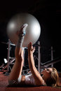 Woman exercising pilates ball workout posture in fitness club Stock Photography