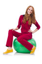 Woman exercising with swiss ball on white Stock Photography