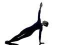 Woman exercising Vasisthasana side plank pose yoga silhouette