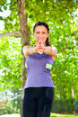 Woman exercising yoga in park beautiful Stock Image