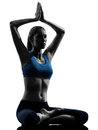 Woman exercising yoga sitting hands joined Stock Image