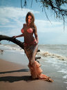 Woman in exotic dress standing on the beach Stock Photography