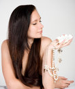 Woman with exotic shell Stock Photography