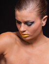 Woman with extreme colorfull make up in blue and yellow on black background Royalty Free Stock Images