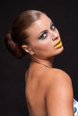 Woman with extreme colorfull make up in blue and yellow on black background Stock Photo
