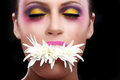 Woman with extreme spattered make up on the face beautiful Stock Photography