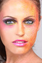 Woman with extreme spattered make up on the face beautiful Royalty Free Stock Photos