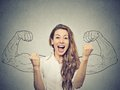 Woman exults pumping fists ecstatic celebrates success happy on gray wall background Royalty Free Stock Photos