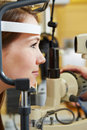 Woman at eye examination with slit young lamp optician Royalty Free Stock Photography