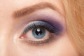 Woman eye with makeup close up of beautiful blue bright colorful looking at camera Royalty Free Stock Photography