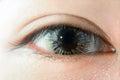 Woman eye wearing fancy contact lens Royalty Free Stock Photo