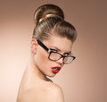 Woman in eyeglasses strict retro style female with red lipstick wearing studio shot of beautiful lady spectacles Stock Photography