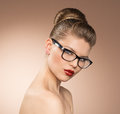 Woman in eyeglasses studio shot of young beautiful lady glasses looking at camera vintage style female portrait Stock Image