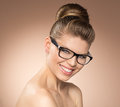 Woman in eyeglasses young stylish attractive girl optical glasses posing studio smiling and beautiful caucasian female model Stock Photography