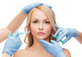 Woman face and beautician hands with syringes beauty cosmetic surgery concept Royalty Free Stock Photo