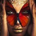 Woman face and butterfly creative composite colorful photo close up Royalty Free Stock Photo