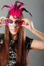 Woman face with carnival mask on gray Royalty Free Stock Photo