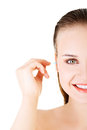 Woman face closeup while cleaning up an ear with a swab over white Royalty Free Stock Photo