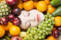 Woman face in fruits healthy nutrition and diet concept Royalty Free Stock Images