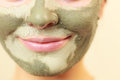 Woman Face With Green Clay Mud...