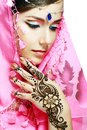 Woman face henna on hand beautiful girl with perfect arabian make up with with detail of being applied to it isolated Royalty Free Stock Image