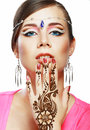 Woman face henna on hand beautiful girl with perfect arabian make up with with detail of being applied to it isolated Stock Photography