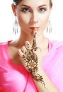 Woman face henna on hand beautiful girl with perfect arabian make up with with detail of being applied to it isolated Stock Image