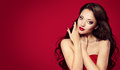 Woman Face on Red, Fashion Model Makeup Beauty Portrait Royalty Free Stock Photo
