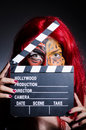 Woman with facepaint and movie clapper Stock Images