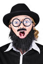 Woman with fake beard and mustache screaming portrait of disguised as man on white background Stock Photo