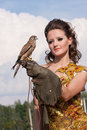 The woman with falcon Royalty Free Stock Photos