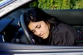 Woman falling asleep on wheel in car drunk young sleeping Stock Images