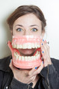 Woman false teeth pretty young with oversized denture Royalty Free Stock Photography