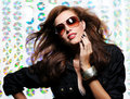 Woman  with fanning hairs and  fashion sunglasses Royalty Free Stock Image