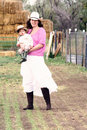 Woman Farmer With Her Son Royalty Free Stock Photos