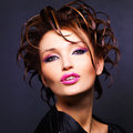 Woman with fashion hairstyle and bright sexy pink lips beautiful posing at studio Stock Photos