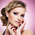 Woman with fashion hairstyle and pink makeup beautiful Stock Photos